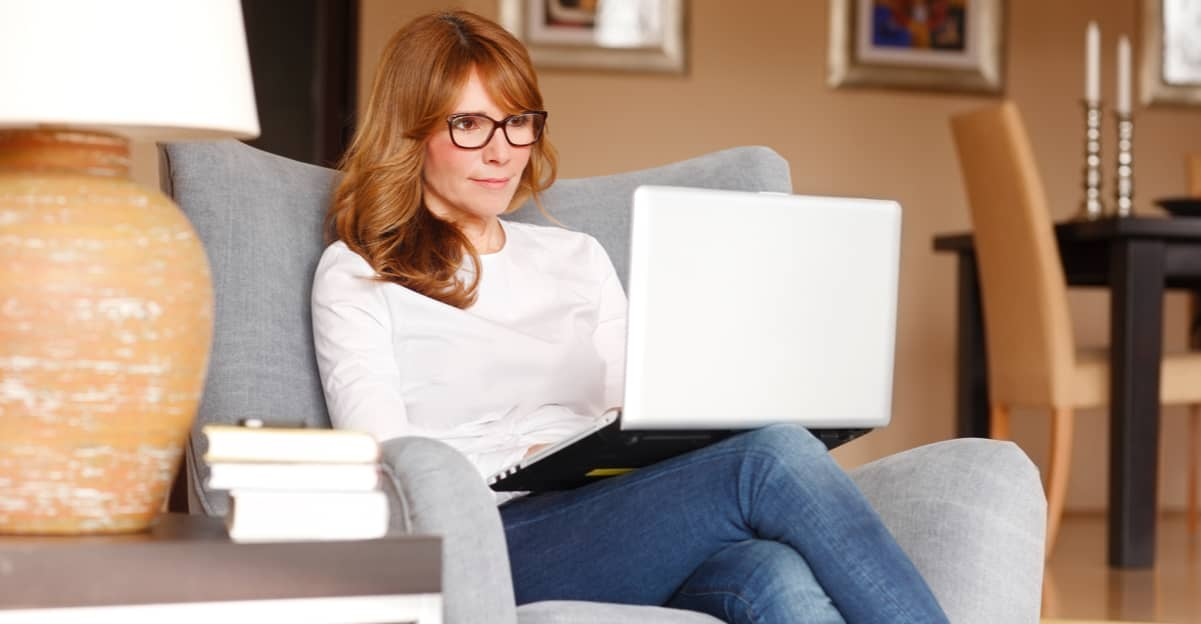 woman with glasses on her laptop