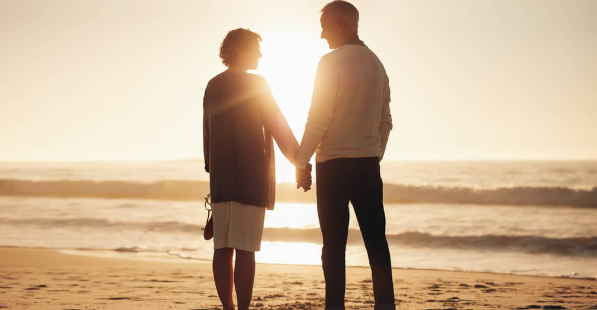 mature man and woman looking off into the sunset